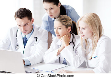 group of doctors looking at tablet pc - healthcare, medical ...