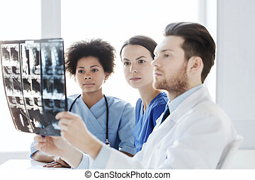 group of doctors looking to x-ray at hospital