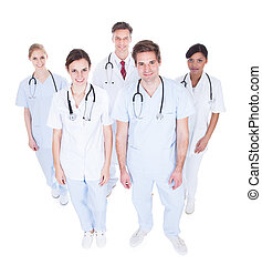 Group Of Doctors Looking Up