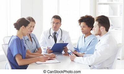 group of doctors meeting at hospital office