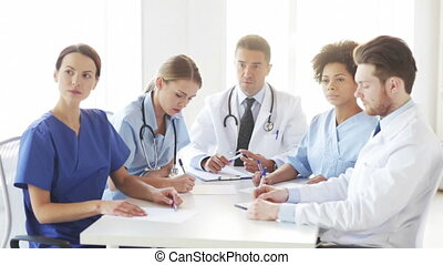 group of doctors meeting at seminar in hospital