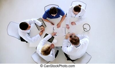 group of doctors on conference at hospital - medicine,...
