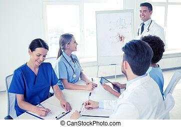 group of doctors on presentation at hospital - medical...