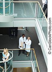 Group of doctors walking in hospital
