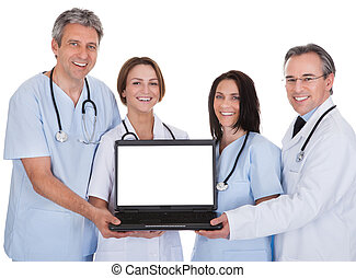 Group Of Doctors With A Laptop