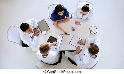 group of doctors with cardiogram at hospital