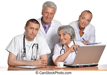 Group of doctors with laptop