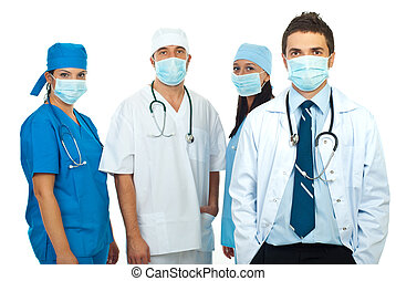 Group of doctors with masks