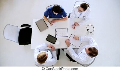 group of doctors with medical report at hospital