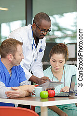 group of doctors with pc computer