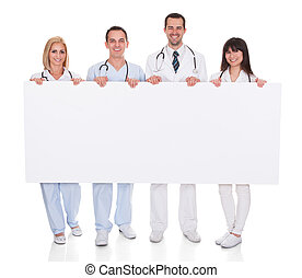 Group Of Doctors With Placard
