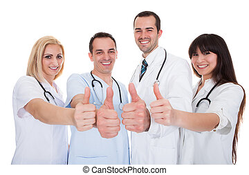 Group Of Doctors With Thumb-up Sign