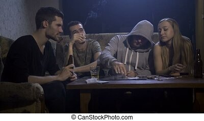 Group of drug addicts ready to snort cocaine