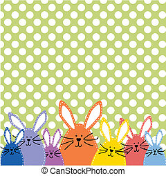 Group of Easter bunnies, in spring colors on polka dot...