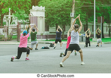 Group of elderly friend doing aerobic dance after work   together at Lumpini Park in Bangkok, Thailand.