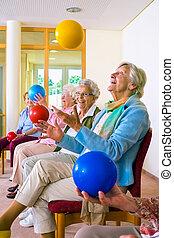 Group of elderly ladies in a seniors gym