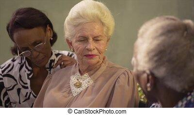 Group of elderly women talking