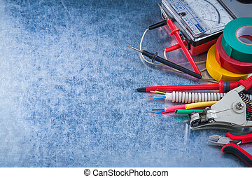 Group of electrical equipment on metallic background horizontal