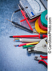 Group of electrical equipment on metallic surface ...
