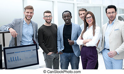group of employees standing in the office