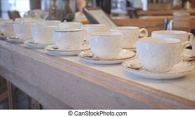 Group of empty cups in many rows of a white cup for coffee...