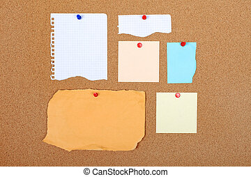 Group of empty paper attached to cork board. Empty space for...