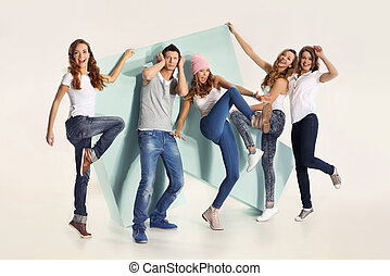 Group of energetic young people - The team of five young...