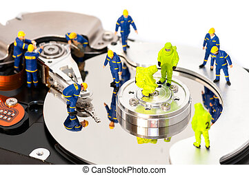 Group of engineers maintaining hard drive. Computer repair...