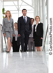 Group of executives climbing stairs