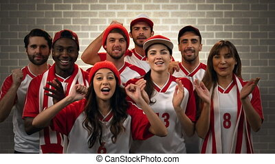 Group of fans cheering for their team - Digital composite of...