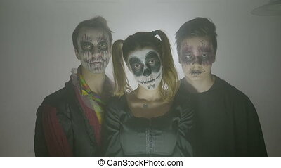 Group of female and male halloween zombies with costumes and...