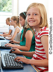 Group Of Female Elementary School Children In Computer Class