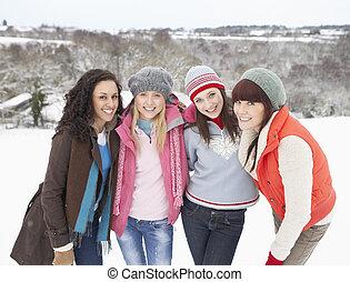 Group Of Female Friends Having Fun In Snowy Landscape
