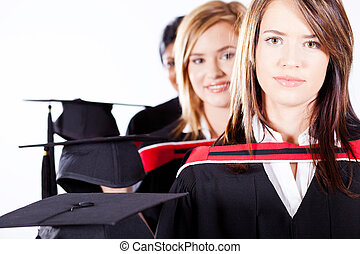 female graduates holding graduation caps
