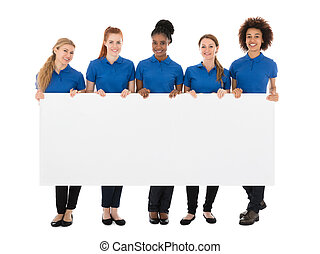 Group Of Female Janitors Holding Billboard