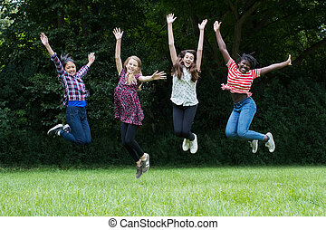 Group Of Female Teenage Friends Leaping In The Air