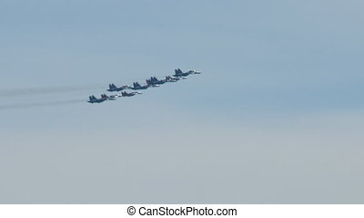 Group of fighter planes performing in the sky