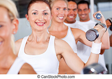 people lifting weight in gym