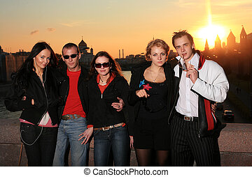 Group of five friends posing in Moscow