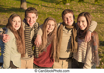 Group of Five Teens Embracing