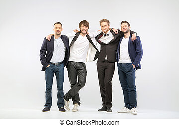 Group of four cheerful male friends
