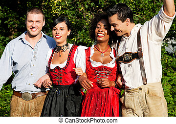 Group of four friends in Bavarian Tracht