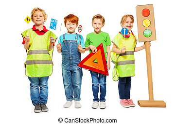 Group of four kids studying road safety rules - Four kids in...
