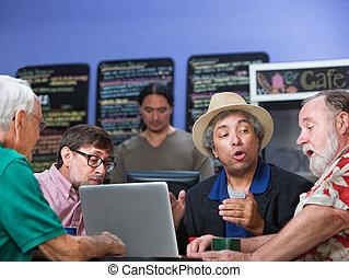 Group of Four Men Talking
