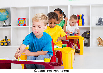 preschool kids in classroom paint