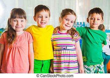 Group of four preschoolers