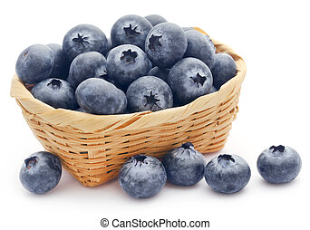 Group of fresh blueberries in a basket over white background