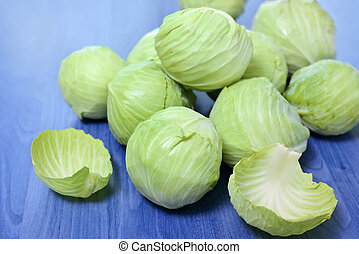 Group of Fresh Cabbages on blue background