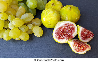 Group of fresh figs and green grapes