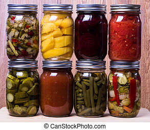 Group of fresh homemade preserved vegetables and fruits -...